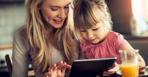 Blog | Featured Image Playing Tablet Co-parenting