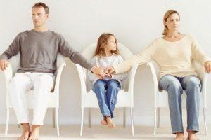 Co-Parenting Parents Holding Child