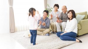 Family Applauding Child Proud